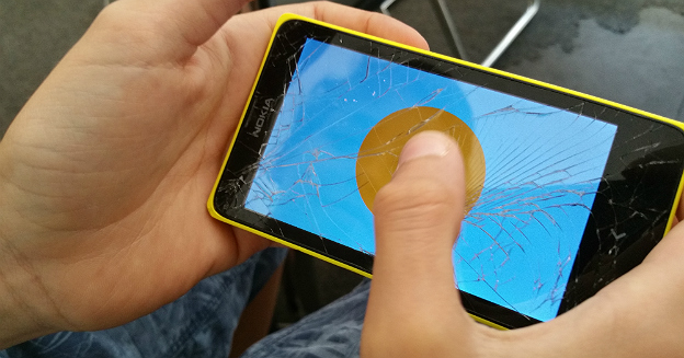 playing-game-on-broken-glass-smartphone-nokia-android-19790203953-iwan-gabovitch-part-img-top